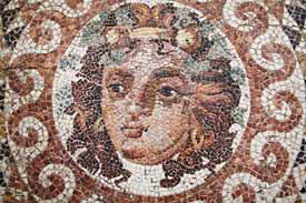 The head of Dionysos, detail from a beautifully preserved mosaic floor from a Roman villa (2nd century A.D). Dionysos is the Greek god of wine and madness, vegetation, and the theatre, and was the focus of various mystery cults. Archaeological Museum of Ancient Corinth.
