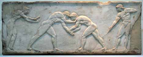 Wrestlers on the base of a funerary kouros found in Athens, built into the Themistokleian wall, 510 to 500 BC.