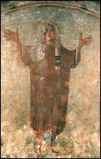Orante with hands lifted in prayer from the Catacomb of Priscilla, Rome.