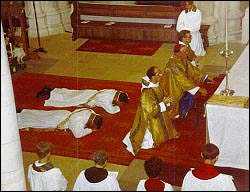 Candidates for Catholic priesthood lie prostrate in the service of ordination.