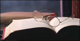 Bible study open book with glasses
