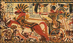 A painted box from Tutankhamen's tomb depicts the Pharaoh on a chariot chasing Nubians (1323 BC).