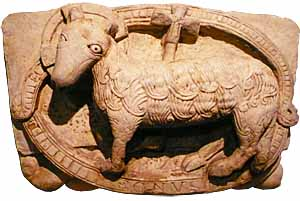 Agnus Dei, detail of lost portal, workshop of the master of Cabestany, at monastery Sant Pere de Rodas,  Catalonia, Spain, now at Marès Museum, Barcelona.