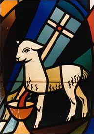 Stained glass showing Lamb of God with vexillum and chalice, from chapel that used to be part of a convent (now a Baptist church and school complex) in El Cajon, California.